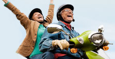 Retired man and woman on motorcycle